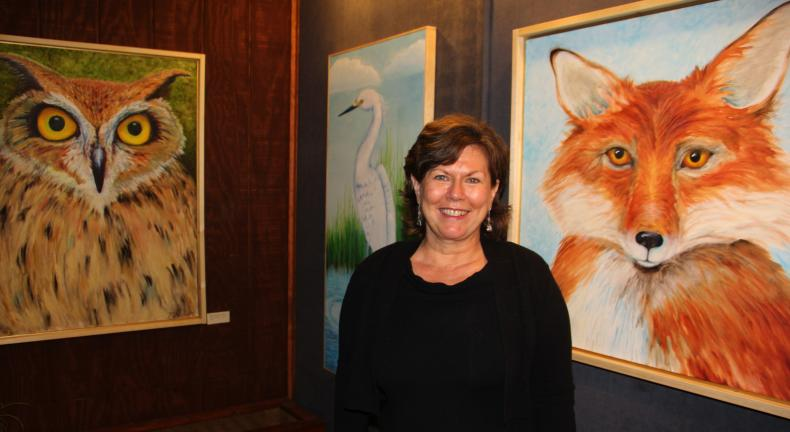 ANDREW LEIBENGUTH/TIMES NEWS Artist Patty Passick stands with some of her works.