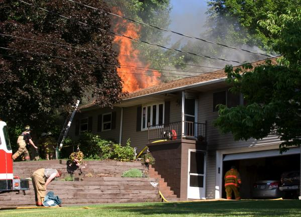 Bob Ford/TIMES NEWS Flames erupt through the roof of the home of Richard and Connie Kistler in the Mahoning Heights section of Mahoning Township this morning. See additional photos on Page 2.