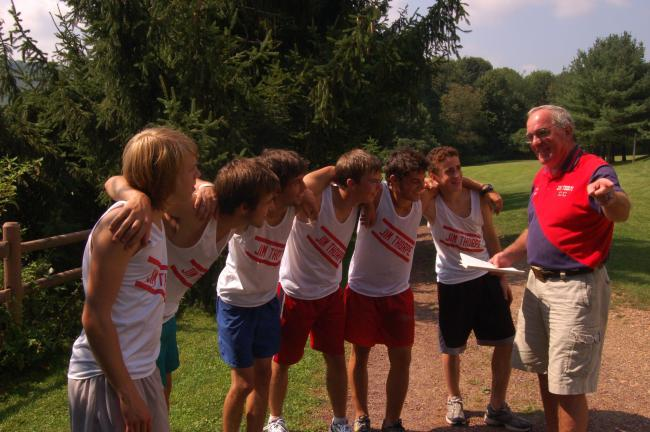 TIMES NEWS File Photo Drew Benyo (right), long-time Jim Thjorpe cross country coach, talks to one of his teams prior to a meet. Benyo has been nominated for the Brooks Inspiring Coach Award.