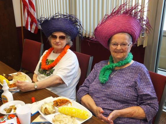 STACEY SOLT/TIMES NEWS Georgene Binder, left, and Miriam Borosh enjoy lunch during the Lehighton High Rise's annual summer safety program. Both are residents at the High Rise.