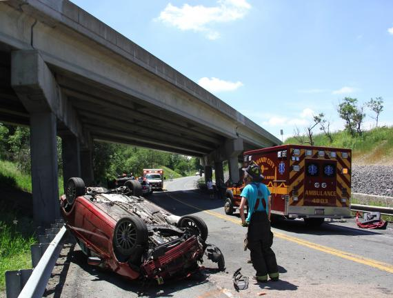 ANDREW LEIBENGUTH/TIMES NEWS Tina Marie Enweiler, 31, of North Carolina, was injured during a one-vehicle accident shortly after noon on Sunday on Interstate 81 in Schuylkill County.