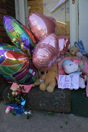 ANDREW LEIBENGUTH/TIMES NEWS Balloons, stuffed animals and cards are placed at the front door of 25 South Kennedy Drive from where 6-year old Madison Arner was carried out Saturday night. Despite a heroic rescue by firefighters, she later succumbed…