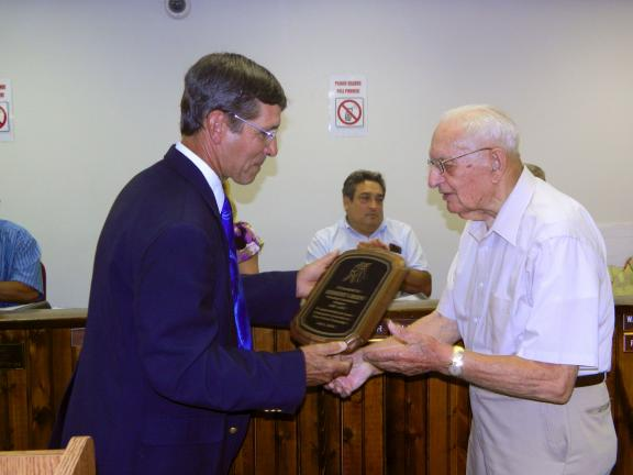 JUDY DOLGOS-KRAMER/SPECIAL TO THE TIMES NEWS Penn Forest Township Planning Commission Chairman Allen Heydt presents a plague to Herbert L. Green for his 29 years of service to the planning commission.
