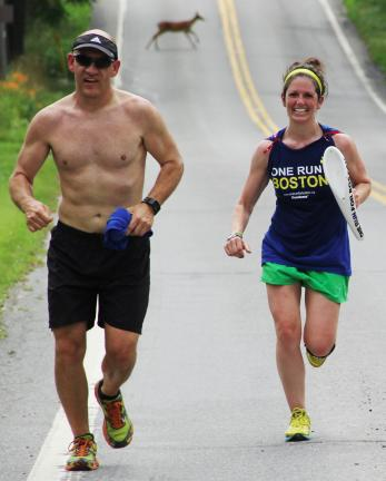 ANDREW LEIBENGUTH/TIMES NEWS A deer runs across SR895 in East Penn Township as Steve Bender, 39, and Jenn Wargo, 32, run 9 miles as part of the One Run For Boston relay marathon. Bender also ran a 6 stages of the relay in New Mexico.