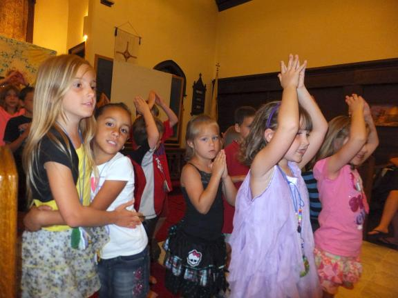 "STACEY SOLT/TIMES NEWS Children attending the Jim Thorpe Ecumenical Vacation Bible School sing ""Go Tell It on the Mountain"" during their closing program at St. John's Lutheran Church. This year's program was ""Tell It on the Mountain."""