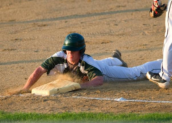 BOB FORD/TIMES NEWS Franklin Hurricanes' Steve Shanton slides into third base during Monday night's Keystone Senior Babe Ruth playoff game against Hazleton. Shanton scored the first run of the game in the Hurricanes win, 4-2.