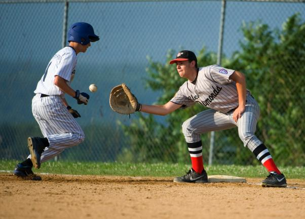 BOB FORD/TIMES NEWS Garrett Krome of the Towamensing Yankees gets back to first on a pickoff attempt as Panther Valley Black Diamonds first baseman Luke Stano takes the late throw.