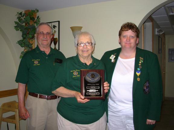 ADELE R. ARGOT/SPECIAL TO THE TIMES NEWS Joanne Rush, center, was recently named the 2012-2013 Western Pocono Lions Club Lion of the Year. Also shown are club President Charles Rush, left, her husband, and Lions District 14U Vice District Governor…