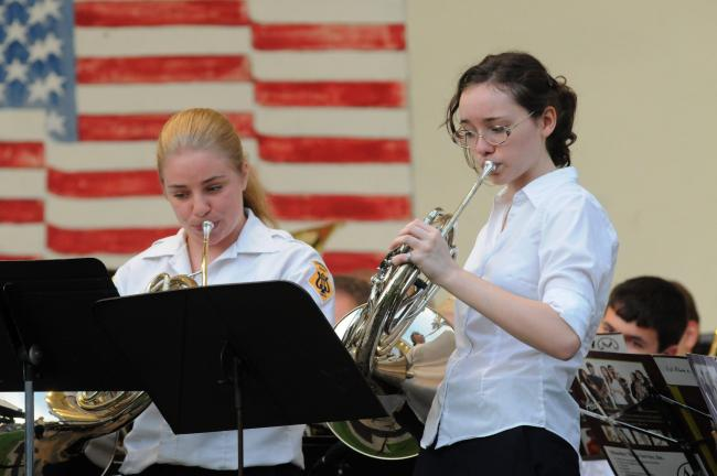 RON GOWER/TIMES NEWS A French horn duet is performed by Laurel Seamiller and Jo deForest during concert by the Lehighton Band held Thursday in the Lehighton Park Amphitheater. The same concert will be staged at 7 p.m. tomorrow in Eurana Park, Weatherly.