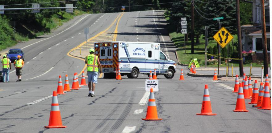 ANDREW LEIBENGUTH/TIMES NEWS Tamaqua Fire Police volunteers set up cones to detour traffic away from a half mile section of SR309 in West Penn Township, Thursday, where a serious traffic accident occurred.