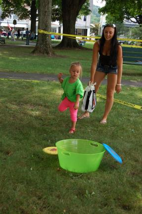 Gia LoPiccolo, 2, daughter of Tiffany (formerly of Weissport) and Francesco LoPiccolo of Macungie, toss a frisbee at the Weissport Park on Saturday.