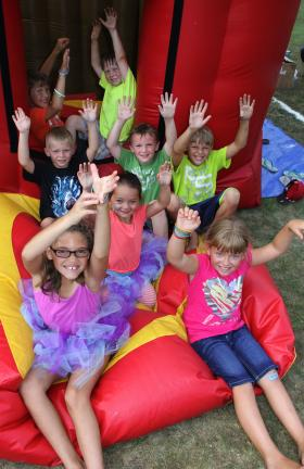 ANDREW LEIBENGUTH/TIMES NEWS Enjoying themselves during Maddyfest on the Lansford Fire Company's inflatable fire safety house are Nick Coniglio, 9; Gavin Pavlik, 7; Hunter Kulaga, 7; Haley Kulaga, 7; Jacob Coniglio, 10; Connor Snyder, 8; Armani…