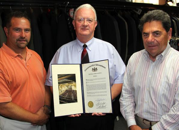 ANDREW LEIBENGUTH/TIMES NEWS Charles X. Block owner Ralph Richards, left, and manager Richard Gibson, right, receive a House citation from Representative Jerry Knowles in recognition of Charles X. Block's 90-year annivesary. Charles X. Block is an…