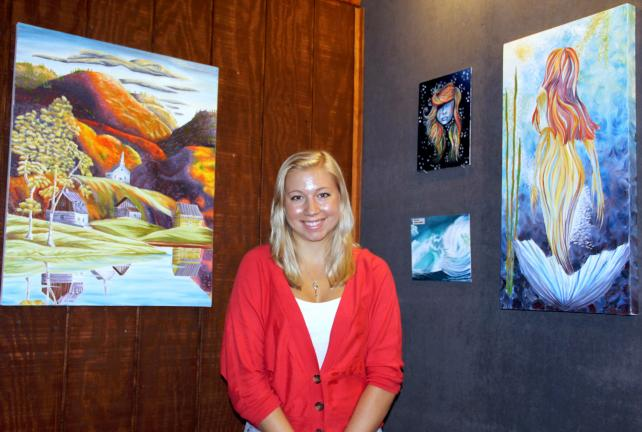 ANDREW LEIBENGUTH/TIMES NEWS Meghan Dailey, 17, stands with some of her work on display at Stonehedge Gardens.