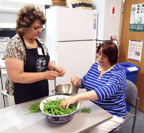 "AL ZAGOFSKY/SPECIAL TO THE TIMES NEWS ""Yes I Can"" workshop leader and Master Food Preserver Dawn Olson (left) snaps beans with Nancy Grotevant, district director Penn State Cooperative Extension Monroe County."