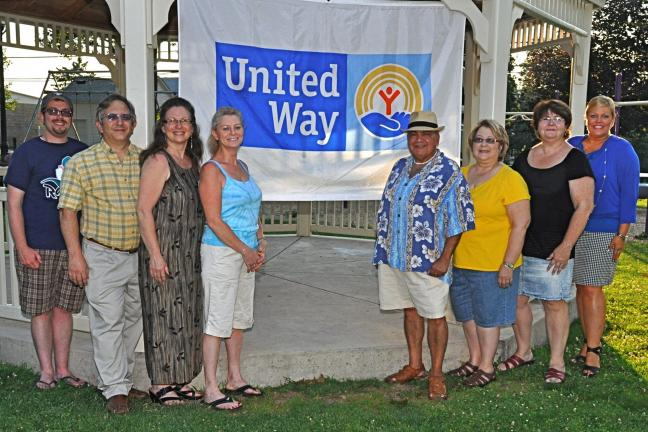 VICTOR IZZO/SPECIAL TO THE TIMES NEWS Displaying the United Way of Carbon County's banner in the Gazebo at Memorial Park in Jim Thorpe for the upcoming United Way 6th Annual Cruise to the Music Festival & Car Show,to be held on August 3, are United…
