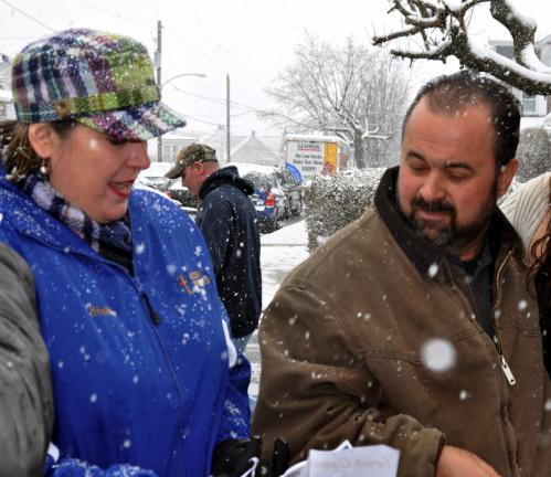 DONALD R. SERFASS/TIMES NEWS Tamaqua resident Sheila Davison gets the attention of TV antiques picker Frank Fritz during a March 13 snowstorm when the cable TV show arrived unexpectedly in Lansford.