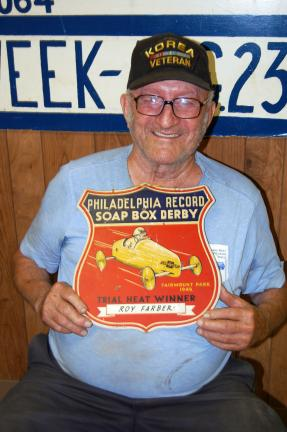 ELSA KERSCHNER/TIMES NEWS Ed Ziegler brought a plaque from Ray Farber's heat win at the Fairmount Park Soap Box Derby. It is hoped there will be one or more soap box cars for the parade.