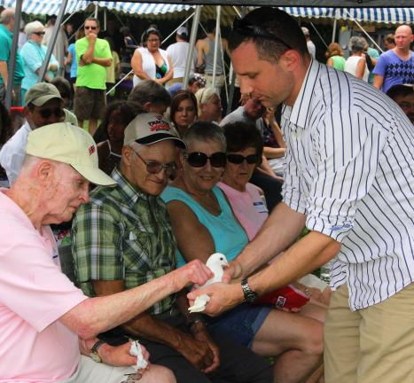 ANDREW LEIBENGUTH/TIMES NEWS @Caption Stand Alone:Cancer survivors picnic Dave Truskowsky holds a dove for cancer survivors, while looking on are, l-r, Roy Arronds of New Philadelphia; Bob Bowman of Lehighton; and Ann Schoener of Mahanoy City. Photo…