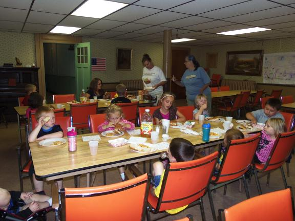 CAROL ZICKLER/SPECIAL TO THE TIMES NEWS The final free lunch of the summer has been served to those attending the program at Meed's Methodist Church. Seen are a group of children from the local day care center.