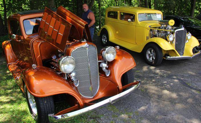 ANDREW LEIBENGUTH/TIMES NEWS @Caption Stand Alone:Antique vehicles On display at the Cars for Christ Auto Show in West Penn Township were these 1933 models. On left is a Ford Tudor sedan owned by Keith Stahler of New Ringgold. On right is a…