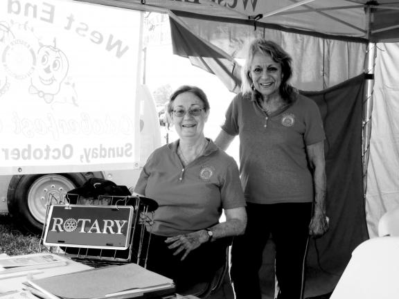 SPECIAL TO THE TIMES NEWS West End Rotary Club members Marge Myler, left, and Joanie Loveless make the West End Fair more accessible by providing wheelchairs to fairgoers.