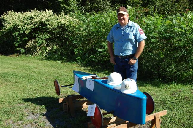 "ELSA KERSCHNER/TIMES NEWS ""They used to run these right down Main Street,"" recalls Herman Turner, as he looks at the soap box derby car on display. It was donated by Tom Mengoni whose son raced in the derbies. Turner said his neighbor's nephew also raced."