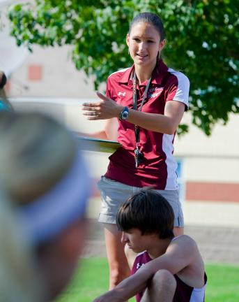 bob ford/times news First-year Lehighton cross country head coach Erica Pagotto talks to team members before a recent practice.