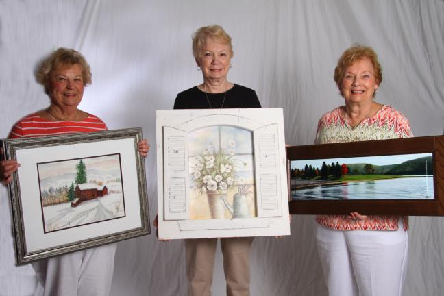 SPECIAL TO THE TIMES NEWS Three of four prizes to be awarded at the Concourse Club of Palmerton's Annual Community Festival Art and Photography Show include, from left, a watercolor winter scene by Margaret Kuhet, held by Kuhet; a shuttered window…