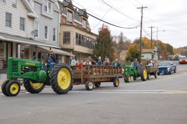 Gail Maholick/TIMES NEWS Lou Seibert and Todd Dreisbach drive John Deere tractors during the 2012 hayride. They will be back again in Weissport to give hay rides along the Lehigh Canal on Oct. 12 and 13. The rides are free, with donations accepted.
