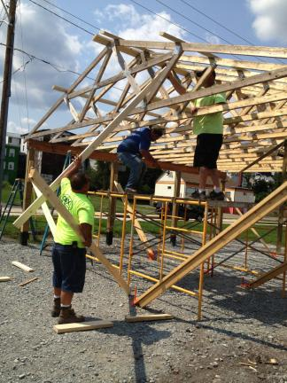 AL ZAGOFSKY/SPECIAL TO THE TIMES NEWS Lehighton borough employees, l-r, Levi Stern, Mike Andrews, and Jeff Smith nail the roof into position on the D&L Trailhead pavilion in Lehighton.