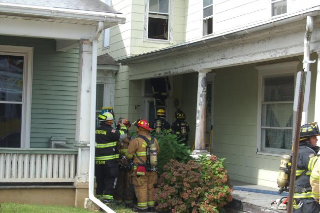 TERRY AHNER/TIMES NEWS Volunteer firefighters work to quell a dwelling fire at a home at 862 Main St. in Slatington Monday morning. The home sustained minor damage. No injuries were reported.