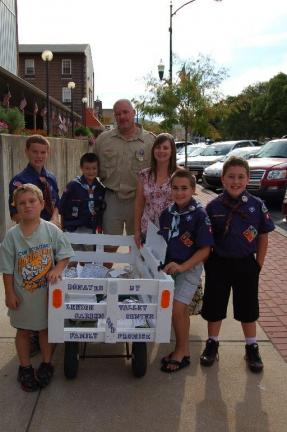 LINDA KOEHLER/TIMES NEWS Family Promise and the Lehigh Valley Garden Center donated funds and a wagon to Cub Scouts Pack 41 so they could deliver food from the Palmerton Community Festival to residents of Palmerton Hi Rise. Those who participated on…