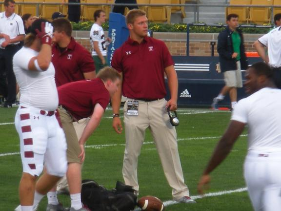 special to the times news Palmerton High School graduate Matt Falcone (center of photo) watches Temple's pregame warmup during the season-opener at Notre Dame. Falcone is a student assistant coach with the Owls.