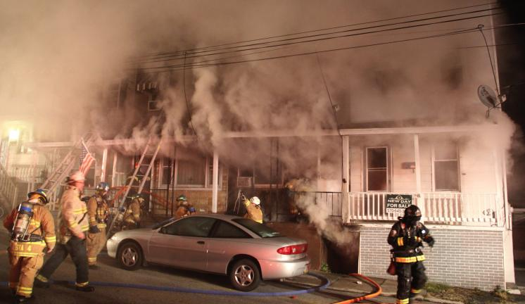 ANDREW LEIBENGUTH/TIMES NEWS Four Tamaqua families are displaced following a fast moving fire that spread thick smoke to nine connected row homes. Four row homes on Coal Street sustained medium to severe damage, while five other connected properties…