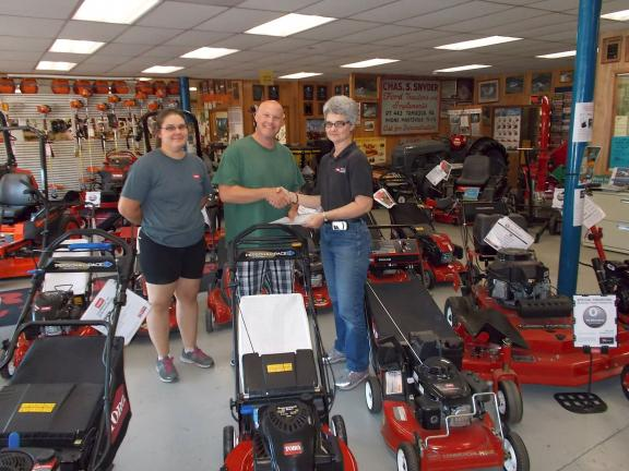 SPECIAL TO THE TIMES NEWS @Caption Stand Alone:West End Fair mower winner The winner of a lawn mower awarded by Charles S. Snyder Inc. of West Penn Township at the West End Fair was Keith Weitknet. Congratulating him are Ann Fogel, left, and Nancy…