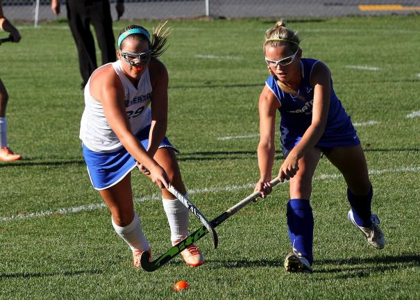 RICH GEORGE/Special to THE TIMES NEWS Palmerton's Mikayla Krupa (left) battles for possession with a Southern Lehig player during Tuesday's Colonial League battle.