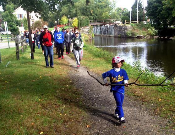 Six-year-old Paige Acevedo of Wind Gap sets the pace for a Delaware & Lehigh National Heritage Corridor tour of the Walnutport section of the Lehigh Canal as her mother, Sherry Acevedo, conservation coordinator for the D&L follows behind, leading…