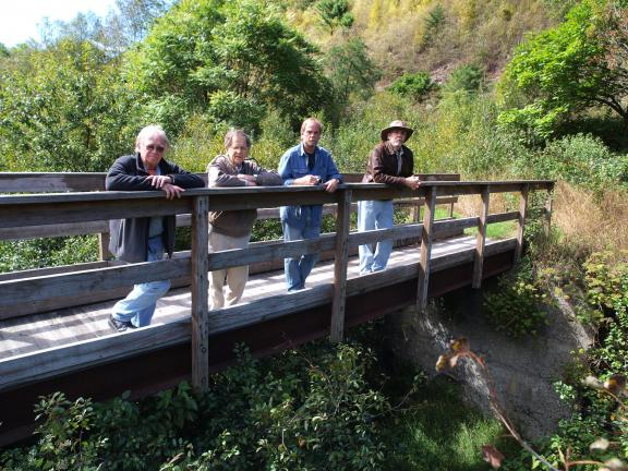 AL ZAGOFSKY/SPECIAL TO THE TIMES NEWS Standing on a bridge along the D&L Trail overlooking the remains of the Lehigh Canal Weigh Lock are, l-r, Steve Hlavka of the Mauch Chunk Historical Society, John Drury of the Mauch Chunk Museum, Robert Heysham…