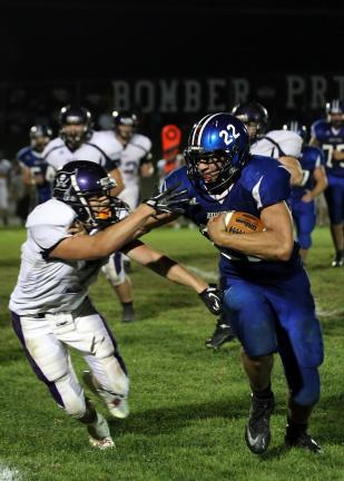 RICH GEORGE/Special to THE TIMES NEWS Palmerton's Tr4e Nelson (22) tries to get away from Palisades' Jesse Snyder for a big gain.