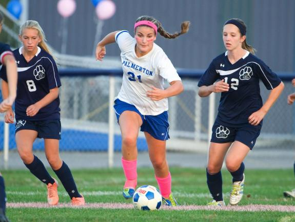 Bob Ford/TIMES NEWS Palmerton's Sabreena Strauch brings the ball upfield between Northern Lehigh's Maddie Ligenza, left, and Holly Yoder during Tuesday's Colonial League soccer contest.