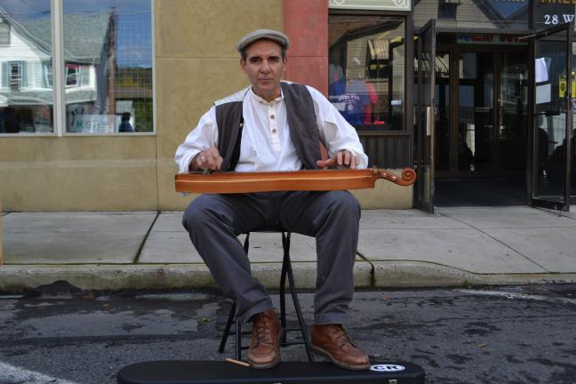 SHERI RYAN/SPECIAL TO THE TIMES NEWS Dave Matsinko plays a mountain dulcimer for visitors at Lansford Alive's craft fair and sidewalk sale held in Lansford.