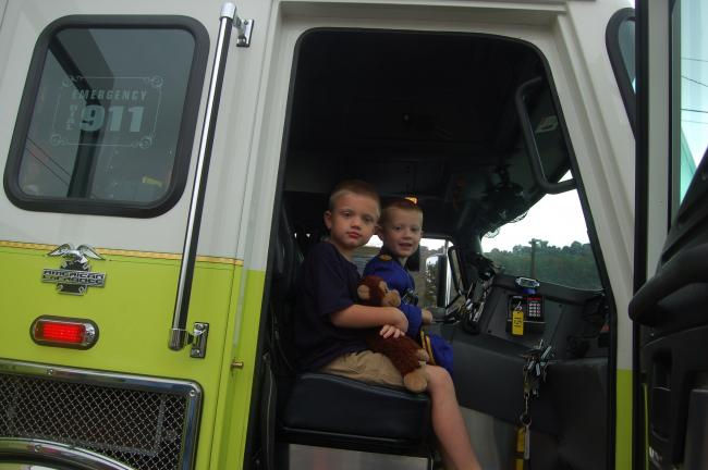 TERRY AHNER/TIMES NEWS Ben and Sean Jahelka of Palmerton prepare to take a ride in the Aquashicola Volunteer Fire Company truck during an open house and public awareness safety day held recently.