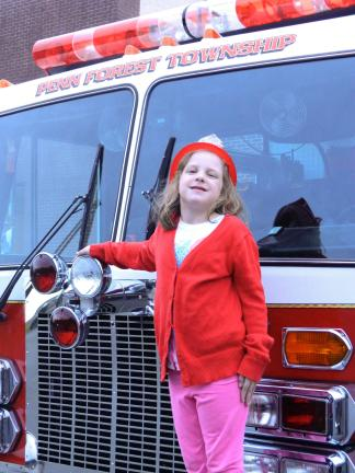 JUDITH DOLGOS-KRAMER/SPECIAL TO THE TIMES NEWS Abigail Dein, 8, of Jim Thorpe poses on a fire truck at Penn Forest Volunteer Fire Company No. 1's annual open house. Many of the fire houses in the area have held special events like this to promote…