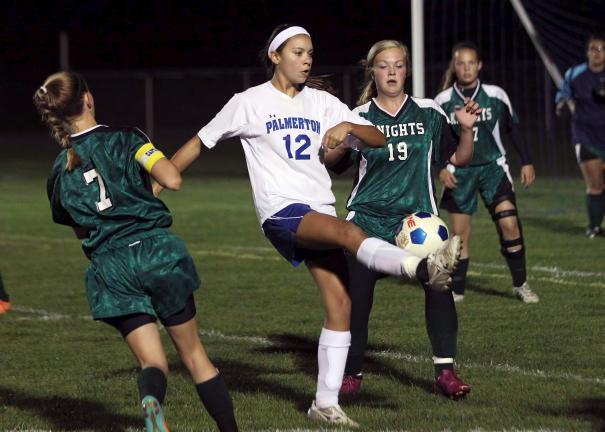 rich george/special to the times news Palmerton's Monica Wood steps in between a pair of Pen Argyl players to try and gain control of the ball.
