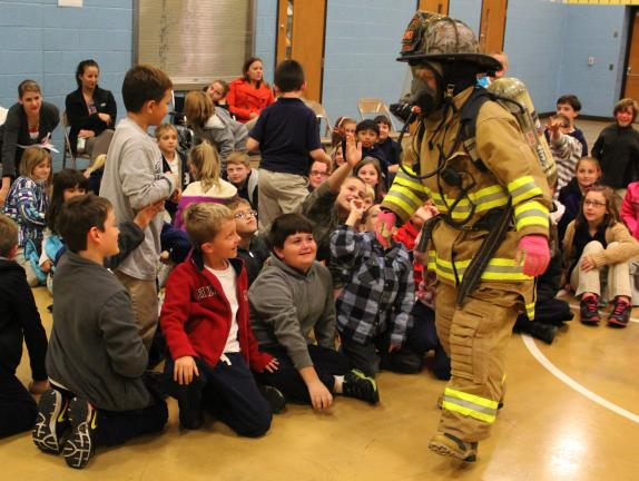 ANDREW LEIBENGUTH/TIMES NEWS Firefighter Cheryl Leone makes the kids cheer as she dances past them during the program.
