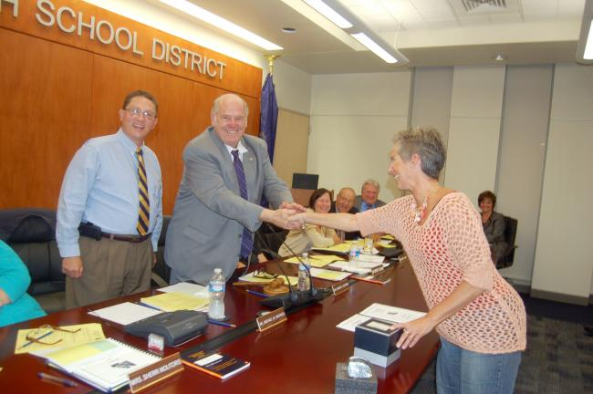TERRY AHNER/TIMES NEWS Recently retired teacher Donna Marushak accepts a gift from Northern Lehigh School Board President Edward Hartman as Superintendent Michael Michaels looks on.
