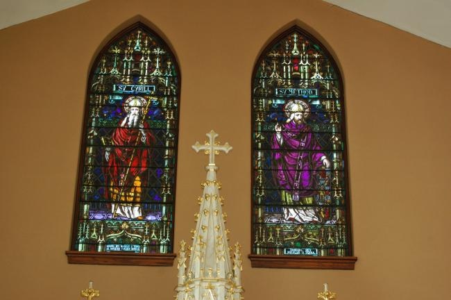 Stained glass windows depicting Saint Cyril, left, and Saint Methodius, adorn the apse of the former SS. Cyril and Methodius Catholic Church in Coaldale.