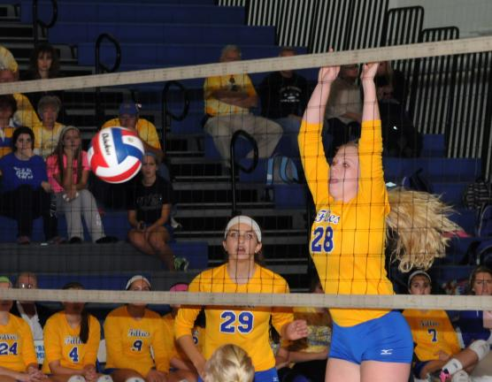 RON GOWER/TIMES NEWS Marian's Sophie Myers (28) goes up for a block during tuesday's match with Pine Grove. The Fillies went on to win in three games and advanced to Thursday night's championship against Pottsville at Martz Hall.