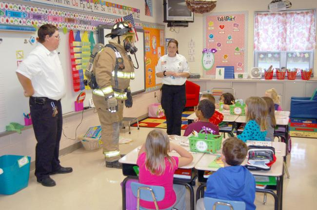 LINDA KOEHLER/TIMES NEWS Towamensing Volunteer Fire Company's Billie Jo Moyer, right, an EMT and volunteer firefighter, talked to Mrs. Green's A.M. kindergarten class about the importance of smoke alarms. Volunteer Tom Woodring showed the children…